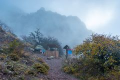 Hiking trail in the mountains, autumn landscape. In the fog stock photography
