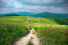 Hiking trail in mountains landscape Stock Photo