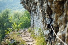 Hiking trail with safety cables Royalty Free Stock Photography