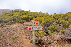 Hiking trail passage Pico Areeiro to Pico Ruivo - signpost showing the  routes Royalty Free Stock Photography