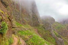 Hiking trail passage Pico Arieiro to Pico Ruivo - path along abyss Royalty Free Stock Photo
