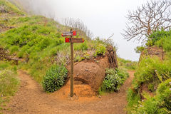 Hiking trail passage Pico Arieiro to Pico Ruivo - signpost showing alternatives routes Stock Image