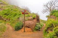 Hiking trail passage Pico Arieiro to Pico Ruivo - signpost showing alternatives routes Stock Image