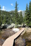 Hiking trail in Rocky Mountains Stock Images