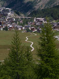 Hiking Trail at Saas Fee. With flowing curves leading out of the village stock photos