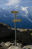 Hiking trail sign. Yellow hiking sign on the mountains of the Mont Blanc hiking trail in France Stock Photos