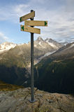 Hiking trail signs. Yellow hiking signs on the mountains of the Mont Blanc hiking trail in France royalty free stock photography