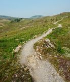 Hiking trail in sunshine royalty free stock photo