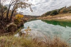Hiking Trail to the Pedernales River on the Reimers Ranch in Texas. Through the ferns and along the creek past caves and cliffs stock images