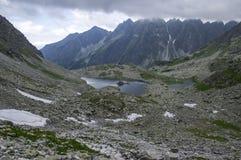 Hiking trail to Rysy mount, aeria view to mountain tarn Big frog. Bad weather royalty free stock photos