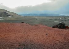 Hiking trail to Viti crater lake, red and black volcanic rock ground in Askja, Highlands of Iceland, Europe stock photo
