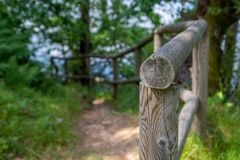 Hiking trail track. With wooden rail Stock Photo