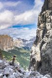 Hiking trail with trail marker in a narrow gorge in the Dolomites Royalty Free Stock Image