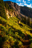 Hiking trail in the upper ice lake basin path way to rocky mountains Royalty Free Stock Photography