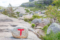 Hiking trails marked with a red T in Norway. Hiking trails marked with a red T by Turistforeningen on cairns and rocks in Norway. In the background there are Royalty Free Stock Photo