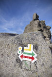 Hiking trails signs painted on rock. Royalty Free Stock Images