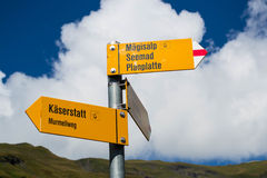 Hiking trails in Swiss Alps. Hiking trail signs at Swiss Alps. Hasliberg region Royalty Free Stock Images