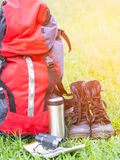 Hiking travel gear on glasses. Items include hiking boots, Royalty Free Stock Photo