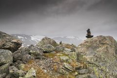 Dramatic mountain landscape in Scandinavia. Hiking travel in Norway during summer vacation in high mountain Royalty Free Stock Images