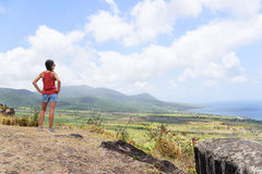 Hiking travel woman looking at St Kitts landscape. Hiking woman on travel excursion during holiday cruise looking at St Kitts and Nevis landscape. Caribbean Royalty Free Stock Photos