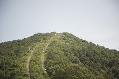 Hiking trial on a steep mountain  Stock Photos