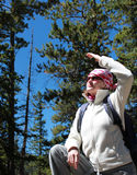 On a hiking trip. Outdoor,travel,trip,adventure concept - hiker with backpack trying to look far out Stock Photos