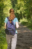 Hiking Trip - Woman on a Path Stock Photography