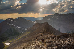 Hiking up into the alpine in Fernie British Columbia. Hikers summiting Mount Trinity in Fernie British Columbia stock photography