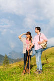 Hiking vacation - man and woman in alp mountains Stock Photo