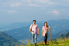 Hiking vacation - man and woman in alp mountains