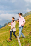 Hiking vacation - man and woman in alp mountains Royalty Free Stock Images