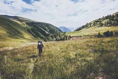 Hiking vacations at wild nature Traveler Man with backpack in mountains Travel Lifestyle concept adventure summer vacations Stock Photos