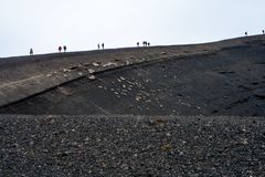 Hiking in a volcanic landscape in Iceland royalty free stock photo