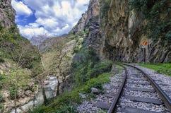 "Hiking at Vouraikos gorge following the Diakopto–Kalavrita ""Odontotos"" rack railway route. Peloponnese - Greece. Sunny day with cloudy blue stock photography"