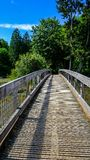 Hiking Walking And Exploring The Beautiful Green And Natural Tolmie State Park In Nisqually Washington On A Bright Late Spring Aft. The bridge that sits above a stock photo