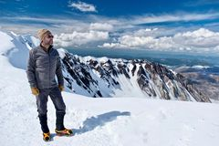 Hiking in Washington. Man climber on mountain top. Happy person on summit of Mount St Helens. National Volcanic Monument. Washington. United States of America stock image