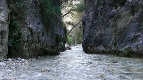 Hiking water. Hiking through the water in the river screaming nerja malaga stock video footage
