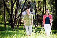 Hiking In The Wild Nature. Two young women Hiking In The Wild Nature Stock Images