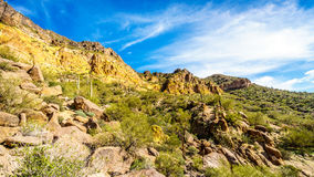 Hiking on the Wind Cave Trail of colorful Usery Mountain surrounded by Large Boulders, Saguaro and other Cacti Royalty Free Stock Images