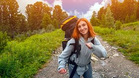 Stylish woman hiking royalty free stock photography