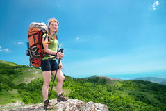 Hiking woman with backpack Stock Photography