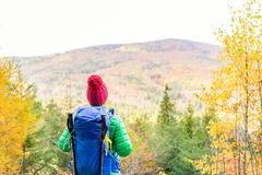 Hiking woman with backpack looking at inspirational autumn golde Royalty Free Stock Image