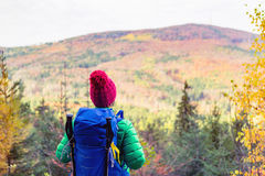 Hiking woman with backpack looking at inspirational autumn mount Royalty Free Stock Photography