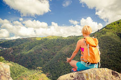 Hiking woman celebrating inspirational mountains landscape. Admire and meditate. Fitness and healthy lifestyle outdoors in colorful summer nature. Trekking Royalty Free Stock Photos