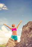 Hiking woman celebrating inspirational mountains landscape Stock Images