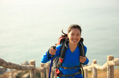 Hiking woman climbing seaside mountain peak Royalty Free Stock Photography