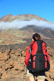 Hiking woman copyspace. Hiking woman looking at mountain peak. The peak is Pico Viejo on the volcano Teide, Tenerife Royalty Free Stock Photography