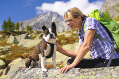 Hiking woman with dog in mountains Stock Photography