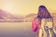 Hiking woman enjoying the Swiss alps landscape Stock Images