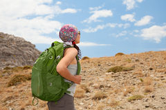 Hiking woman. Female tourist standing on a rock Stock Image